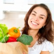 Happy Young Woman with vegetables in shopping bag. Diet Concept — Stock Photo