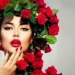 Stock Photo: Beauty Fashion Model Girl Portrait with Red Roses Hairstyle