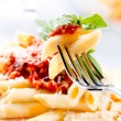 Penne Pasta with Bolognese Sauce, Parmesan Cheese and Basil — Stock Photo #29983971