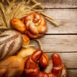 Stock Photo: Bakery Bread and Sheaf over Wood Background