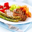 Grilled Beef Steak Meat with Fried Potato, Asparagus, Tomatoes — Stock Photo #29984075