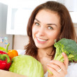 Happy Young Woman with vegetables in shopping bag — Stock Photo #29984077
