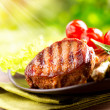 Stock Photo: Grilled Beef Steak BBQ. Barbecue Meat Steak outdoor with Vegetab