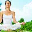 Stock Photo: Yoga. Young woman doing yoga exercise outdoor