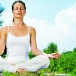 Yoga. Young woman doing yoga exercise outdoor — Stock Photo #29984219