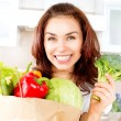 Happy Young Woman with vegetables in shopping bag. Diet Concept — Stock Photo #29984231