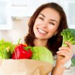 Happy Young Woman with vegetables in shopping bag. Diet Concept — Stock Photo #29984261