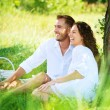 Young Couple Having Picnic in a Park. Happy Family Outdoor  — ストック写真