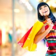 Beauty Woman with Shopping Bags in Shopping Mall — Stock Photo