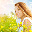 Stock Photo: Beauty Girl in the Meadow lying on Green Grass