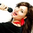 Stock Photo: Beautiful Singing Girl. Beauty Womwith Microphone over White