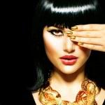 Beauty Brunette Egyptian Woman.Golden Accessories — Stock Photo #29985263