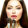 Beauty Girl with Makeup Brushes. Make-up for Brunette Woman — Stock Photo