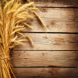 Foto Stock: Wheat Ears on Wooden Table. Harvest concept