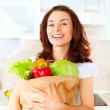 Happy Young Woman with vegetables in shopping bag. Diet Concept — Stock Photo #29985517