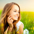 Beauty Girl in the Meadow lying on Green Grass with wild Flowers — Stock Photo