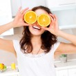 Portrait of Young and Healthy Funny Woman with Orange over Eyes — Stock Photo #29985543