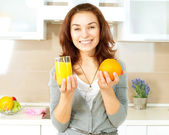 Healthy Girl with Orange Juice in the Kitchen — Stock Photo