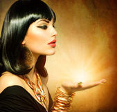 Egyptian Style Woman with Magic Light in Her Hand — Stock Photo