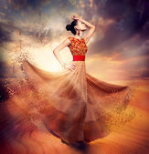 Dancing Fashion Woman wearing Blowing Long Chiffon Dress — Stock Photo