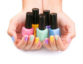 Nail Polish. Manicure. Colored Nail Polish Bottles in the hands — Stock Photo