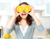 Funny Woman with Orange over Eyes in the Kitchen — Stock Photo