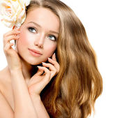 Beauty Girl. Beautiful Model with Rose Flower — Stock Photo