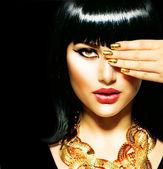 Beauty Brunette Egyptian Woman.Golden Accessories — Stock Photo