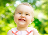 Little Baby Girl Portrait outdoor. Child over nature background — Stock Photo