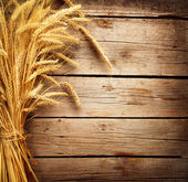 Wheat Ears on the Wooden Table. Harvest concept — Stock Photo