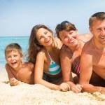Happy Family Having Fun at the Beach. Vacation concept — Stock Photo #35709573