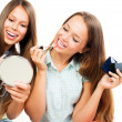 Pretty Teenage Girls Applying Make up and Looking in the Mirror  — Stock Photo
