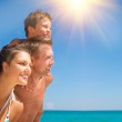 Happy Young Family with Little Kid Having Fun at the Beach — Stock Photo