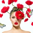 Beauty Fashion Model Woman with Red Poppy Flowers in her Hair — Stock Photo #35710243