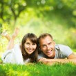 Happy Smiling Couple Together Relaxing on Green Grass Outdoor — Stock Photo