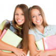 Students Portrait. Cute Attractive Teenage Girls Holding Books — Stock Photo #35710285