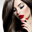 Stock Photo: Sexy Beauty Girl with Red Lips and Nails. Provocative Make up
