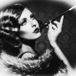 Smoking Retro Woman. Vintage Styled Black and White Photo — Stockfoto #35710533