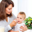 Mother Feeding Her Baby Girl with a Spoon  — Foto Stock