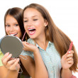 Pretty Teenage Girls Applying Make up and Looking in the Mirror — Foto de Stock   #35710717