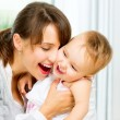 Happy Smiling Mother and Baby kissing and hugging at Home — ストック写真