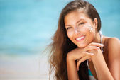 Beautiful happy Girl applying Sun Tan Cream on her Face — Stockfoto