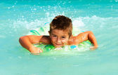 Happy Child Playing in Swimming in Sea. Summer Vacations Concept — Stock Photo
