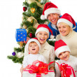 Christmas Family With Gifts near a Christmas Tree — Stock Photo
