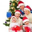 Stock Photo: Christmas Family With Gifts near a Christmas Tree