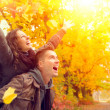 Happy Couple in Autumn Park. Fall. Family Having Fun Outdoors — Stock fotografie