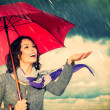 Smiling Woman with Umbrella over Autumn Rain Background — Stock Photo