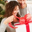 Christmas Gift. Happy Couple with Christmas and New Year Gift at — Lizenzfreies Foto