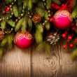Christmas Tree and Decorations Over Wooden Background — Stock Photo