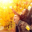 Happy Couple in Autumn Park. Fall. Family Having Fun Outdoors — Stock Photo #36297159